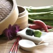 Chinese cooking set with oriental ingredients of long beans, chili and local limes. — Stock Photo