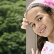 Stock Photo: Beautiful young girl of mix parentage on garden terrace