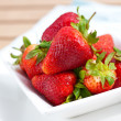 Stock Photo: Bowl of fresh ripened and juicy strawberries.