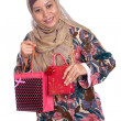 Beautiful Muslim woman with brightly colored shopping bags — Stock Photo