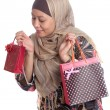 Beautiful Muslim woman with brightly colored shopping bags — Stock Photo #12038411