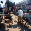 PATHEIN MYANMAR - JAN 30. Trishaw operator ferrying locals from market, 30 Jan 2010, Pathein, Myanmar. The most common method of transport for the locals - Stock Photo