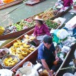 Stock Photo: BANGKOK THAILAND - JAN 20. Busy sunday morning at Damnoen Saduak floating market, Bangkok Thailand J20 , 2010. Locals selling fresh produce, cooked food and souve