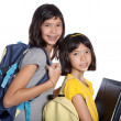 Two pretty sisters wit folders, files and bags ready for school — Stock Photo
