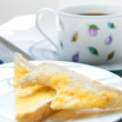 Two slices of toast with a cup of coffee for breakfast. — Stock Photo