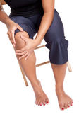 Woman suffering from pain on her knee, isolated — Stock Photo