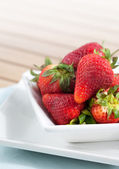 Bowlful of fresh ripened strawberries with room for text — Stock Photo