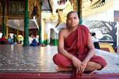 YANGON, MYANMAR - JAN 28: Buddhist monk at the full moon festival, Shwedagon Pagoda, January 28, 2010 in Myanmar (Burma). — Stock Photo
