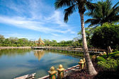 A Buddhist shrine in the middle of a lake in a garden in Myanmar. — Stock Photo