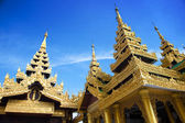 Beautiful temple structures encircling the main pagoda of Shwedagon, Yangon, Myanmar. — Stock Photo