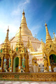 Central pagoda surrounded by hundreds of smaller shrines of Shwedagon pagoda, Yangon, Myanmar. — Stock Photo
