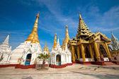 Ornate golden temple shrine encircling the main structure at Shwedagon Pagoda, Yangon, Myanmar. — Stock Photo