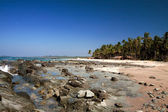 Beautiful rocky beach on a clear day, in the west coast town of SinMa, Myanmar. — Stock Photo