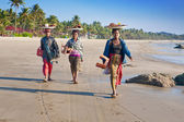 NGWE SAUNG MYANMAR - 2ND FEBRUARY. Three local Burmese women selling grilled fish to visitors along the beach of Ngwe Saung, Myanmar 2nd February 2010. — Stock Photo