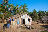 Traditional rural house made out of natural material on the poorer west coast of Myanmar. — Stock Photo