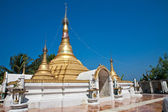Golden pagoda, a place for Buddhist worshippers on fisherman island off the west coast Chaungtha of Myanmar. — Stock Photo