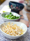 Bowls of steamed oriental vegetables, bean sprouts and baby bok choi. — Stock Photo