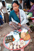 YANGON MYANMAR - JAN 30. Lady hawker selling home cook local breakfast at bus station, Yangon 30th January, 2010. — Stock Photo