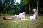 Beautiful senior couple enjoying the summer park — Stok fotoğraf
