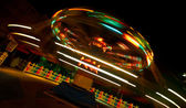Slow shutter work of a playground ride at night time — Stock Photo