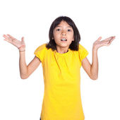 Young Asian girl shrugging shoulders — Stock Photo