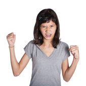 A very angry young girl with fist in air about to hit — Stock Photo