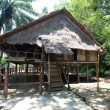' Rumah Lotud'' ( Lotud House ), at Monsopiad Cultural Village, Sabah, being one of the typical type of traditional tribal house atypically found in Sabah, Borneo. - Stock Photo