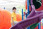 Young boy at colorful outdoor playground — Stock Photo
