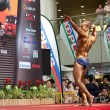 Participant for bodybuilding competion flexing a pose at Toa Payoh Hub - Foto de Stock