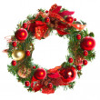 Red christmas garland with baubles and ribbons on white. — Stock Photo