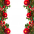 Border of red christmas garland with baubles and ribbons on white. — Stock Photo #19826135