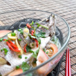 Royalty-Free Stock Photo: Steamed seabass with ginger, garlic, spring onion and tomato.