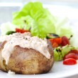 Baked jacket potato with tuna and fresh salad - Stock Photo