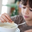 Young boy enjoying a bowl of soup — Stock Photo