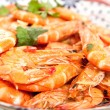 Fresh tiger prawns in garlic and chili with coriander - Stock Photo