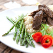 Delicious lamb cous cous with grilled asparagus — Stock Photo
