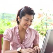 Royalty-Free Stock Photo: Young Asian businesswoman with laptop