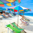 Colorful sundeck chairs and umbrellas on a beach in Thailand — Stock Photo