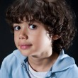 Cute little boy with big eyes and a little smile showing face of curiosity. — Stock Photo #19826823