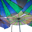 Colorful parasols on a tropical beach. — Stock Photo #19827079