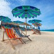 Colorful parasols on a tropical island beach. — Stock Photo #19827393