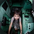 Stock Photo: Excited young boy sitting in a tank at an army open house.