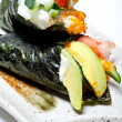 Closeup of Japanese surimi crab stick and avocado temaki — Stock Photo