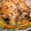 Delicious roast chicken with roasted asparagus and vegetables — Stock Photo