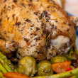 Delicious roast chicken with roasted asparagus and vegetables — Stock Photo #19827905
