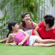 Royalty-Free Stock Photo: Chinese mom having fun with her daughters in the garden