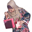 Beautiful Muslim woman with brightly colored shopping bags — Stock Photo #19828793