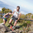Participants climb up Mt Kinabalu in the International Climbathon — Stock Photo