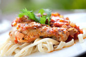 Italian chicken cacciatore served with pasta — Stock Photo