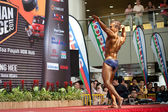 Participant for bodybuilding competion flexing a pose at Toa Payoh Hub — Stock Photo